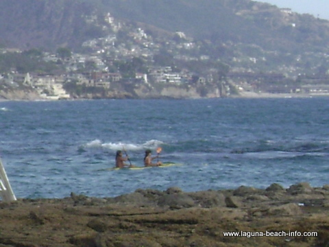 Kayakers at Fishermans Cove, Laguna Beach, California
