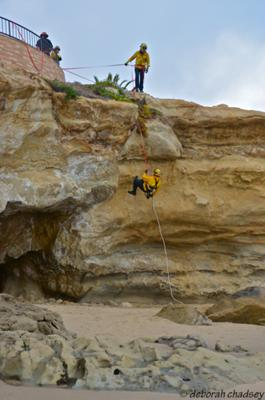 Firefighters practicing cliffside rescues