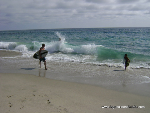 Skimboarders at Thousand Steps Beach, Laguna Beach, California