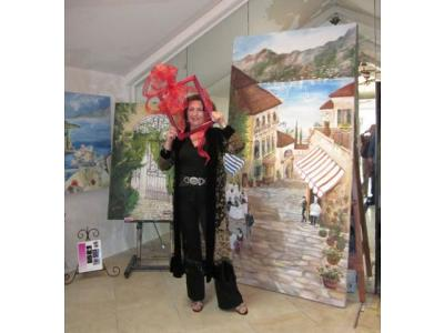 Artist Alexi Allens with her painting